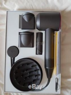 Dyson Supersonic Hairdryer with Attachments and Bag Iron/Fuchsia Nearly new